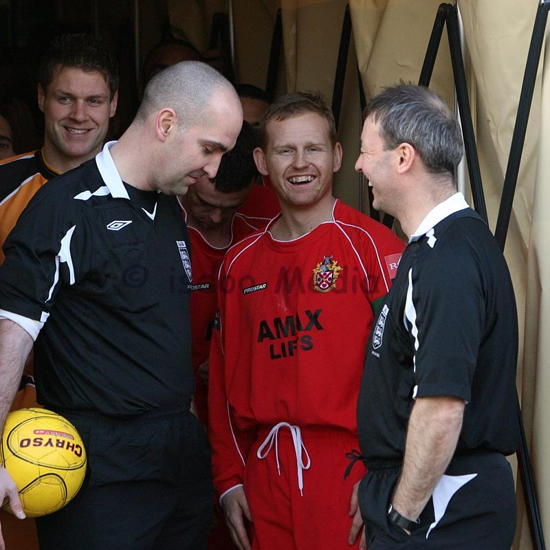 Captain Andy Tomlinson shares a joke with the match officials before the match